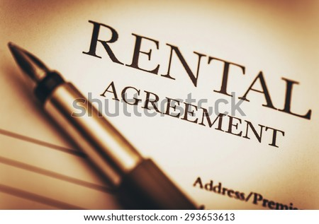 Rental Agreement and Fountain Pen. Ready to Sign Rental Contract. Residential Real Estate Concept Photo. - stock photo
