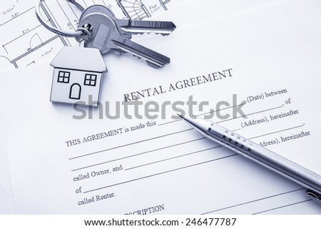 Rental agreement document with keys and pencil - stock photo