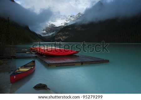 Rental boats on dock at the popular tourist site Lake Louise, Banff National Park (Alberta, Canada) - stock photo