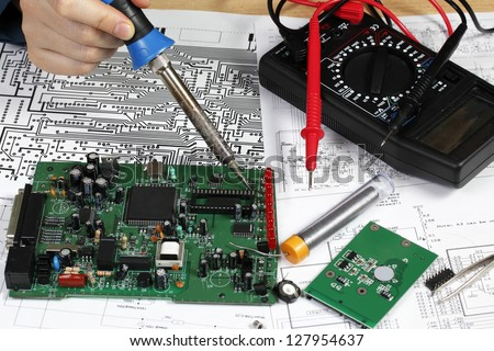 Repair and diagnostic of electronic circuit board - stock photo