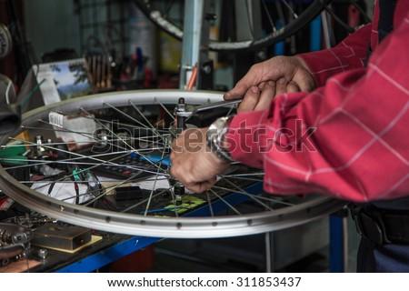Repair bicycles. - stock photo