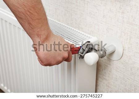 Repair heating radiator close-up - stock photo
