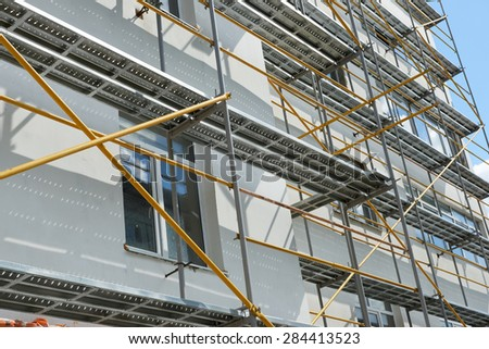 repair home scaffolding building construction - stock photo