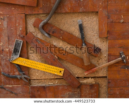 Repair of apartment. Chisel. High quality sharp tool. Shavings. Select a specific focus. Set of tools. Set of tools on wooden background. Set of different work tools. Old laminate. - stock photo