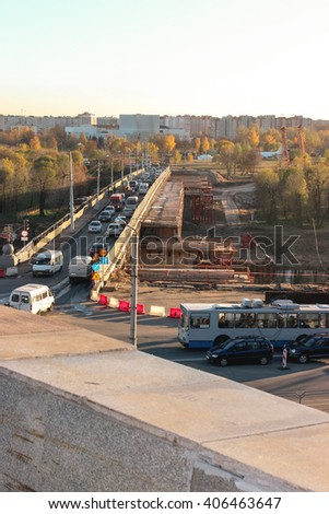 Repair of the bridge, which goes public transport and cars. View repair side. In the background, residential homes and a park for children roundabouts. - stock photo