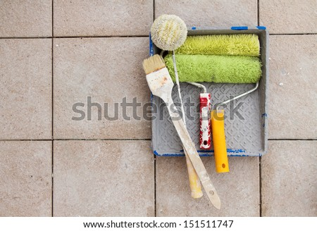Repair tools over stone floor tile background. Copy space. - stock photo