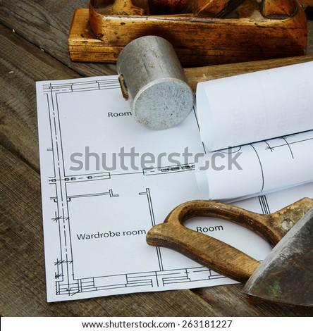 Repair work. Joiner's works. Drawings for building and working tools on wooden background. - stock photo