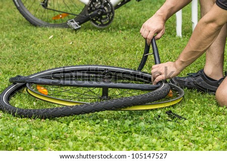 repairing a flat bicycle tire - stock photo