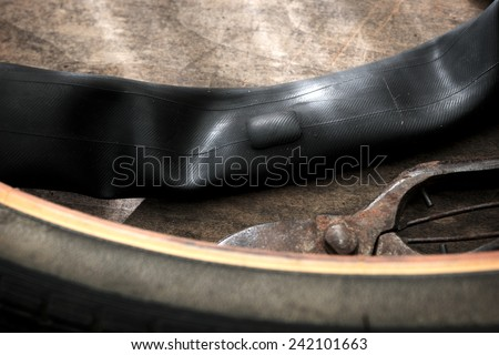 Repairing a flat tire of an bicycle tire. Patched up inner tube of an bicycle tire. - stock photo