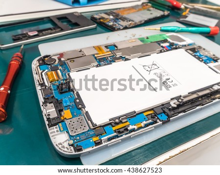 Repairing Tablet and Smart Phone on Desk, Selective Focus - stock photo