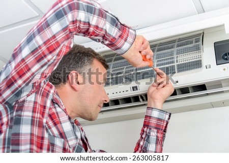 Repairing ventilation system - stock photo