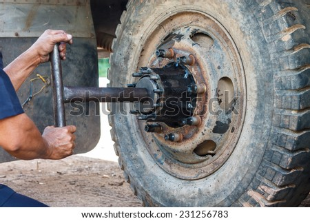 Repairing wheel, by a qualified mechanic. - stock photo