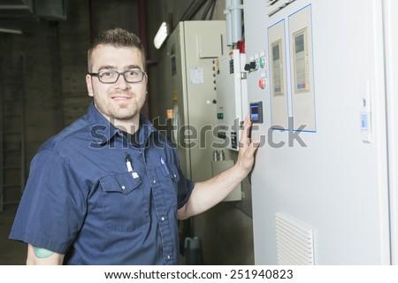 repairman engineer control panel valve equipment in a boiler house - stock photo