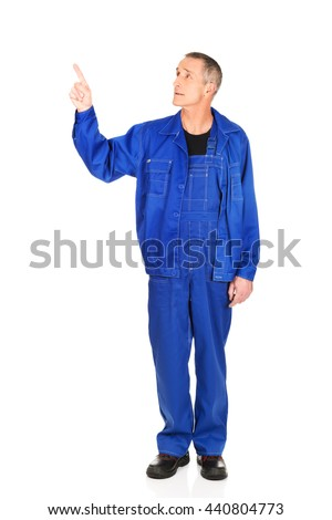 Repairman pointing up  - stock photo