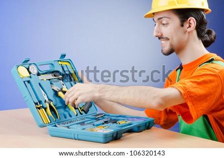 Repairman with his toolkit - stock photo