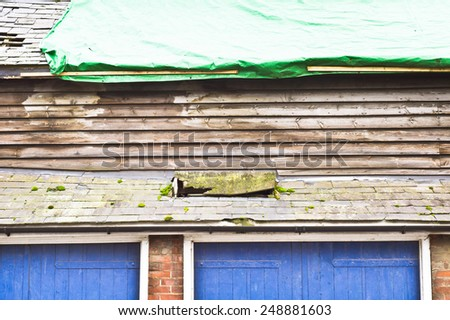 Repairs in progress to a barn roof - stock photo