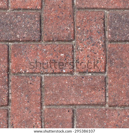 Repeating herringbone paving typically found in developed areas. Often seen in British towns, patios and driveways. The file is a loop ready seamless texture file, allowing the picture to be tiled. - stock photo