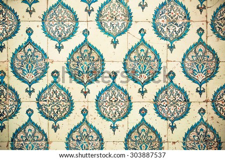 Repeating patterns on ceramic tiles in the old Ottoman style, 15th century Topkapi Palace in Istanbul, Turkey. - stock photo