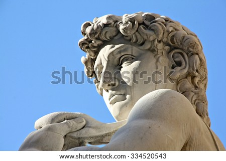 Replica of Michelangelo's David statue against blue sky, Florence, Italy - stock photo