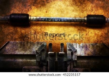 Report on typewriter grunge concept - stock photo