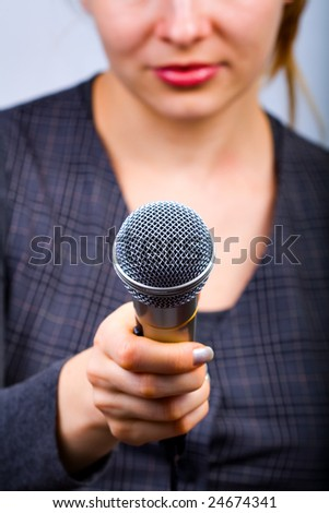 Reporter holding Interview Microphone - stock photo