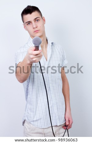 reporter journalist young man holding a microphone and interview - stock photo