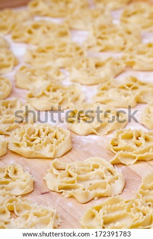 Representation of some Puglia typical Christmas sweets with the use of vincotto  (frosting derived from the slow cooking of figs) as a condiment.  - stock photo