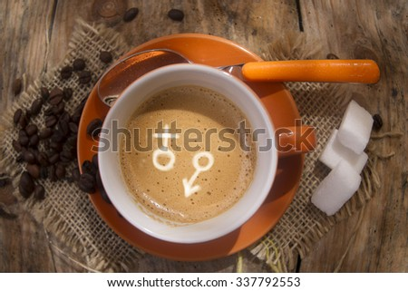 Representation of the symbol of the male and female in a cup of coffee - stock photo