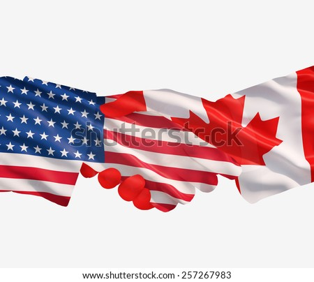 Representatives of the USA and Canada shake hands - stock photo