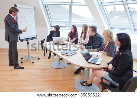 representing something on a flipchart during a meeting - stock photo