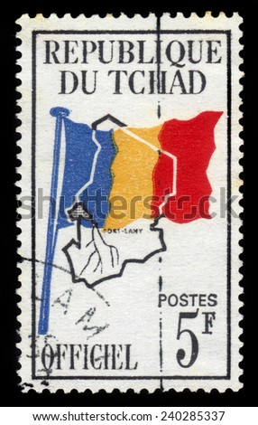 Republic of Chad - CIRCA 1966: A stamp printed in Republic of Chad shows country flag on map of Chad, circa 1966 - stock photo