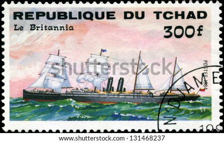 "REPUBLIC OF CHAD - CIRCA 1984: A stamp printed in Republic of Chad shows the ship ""Le Britannia"", series is devoted to sailing vessels, circa 1984 - stock photo"