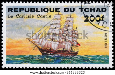 "REPUBLIC OF CHAD - CIRCA 1984: a stamp printed in Republic of Chad shows the ship ""Le Carlisle Castel"" - stock photo"