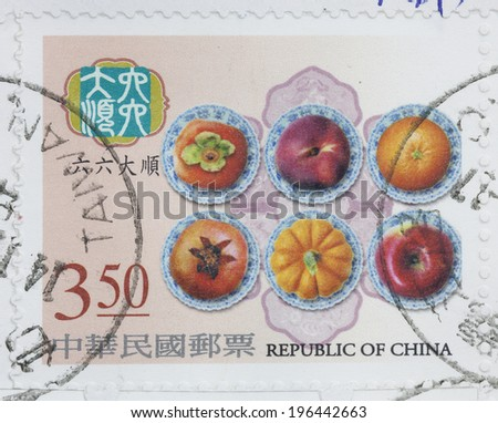 """REPUBLIC OF CHINA (TAIWAN) - CIRCA 2004: A stamp printed in Taiwan shows a picture of six kind of fruits, with the chinese words of """"double six great future"""" for good luck and fortunate, circa 2004 - stock photo"""
