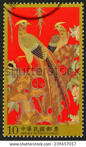 REPUBLIC OF CHINA (TAIWAN) - CIRCA 2013: A stamp printed in Taiwan shows image of Qing auspicious peacock embroidery patterns antiques , circa 2013 - stock photo