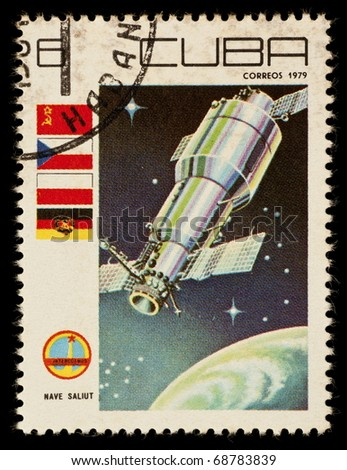 REPUBLIC OF CUBA - CIRCA 1979: A vintage postal stamp printed in Cuba, depicting a space satellite named Nave Saliut in orbit circa 1979 - stock photo