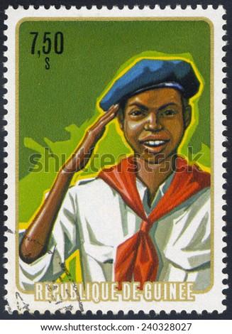 REPUBLIC OF GUINEA - CIRCA 1975: A stamp printed in the Republic of Guinea, shows Salute, circa 1974 - stock photo
