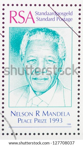 REPUBLIC OF SOUTH AFRICA -Â?Â? CIRCA 1996: A postage stamp printed in Republic of South Africa showing an image of Nelson Mandela, circa  1996. - stock photo