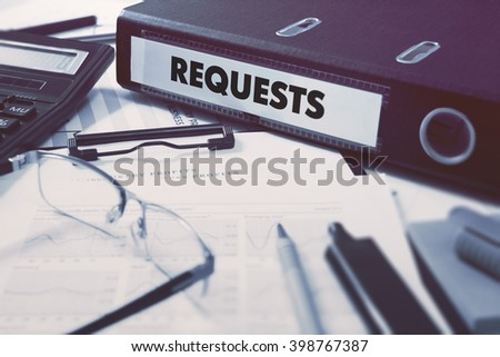 Requests - Office Folder on Background of Working Table with Stationery, Glasses, Reports. Business Concept on Blurred Background. Toned Image. - stock photo
