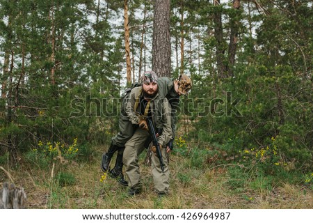 rescue a wounded soldier - stock photo
