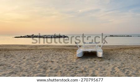 rescue boat on the deserted beach in summer in Rimini Italy - stock photo