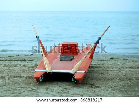 rescue boat rowing for lifeguard on the shore of the sea - stock photo