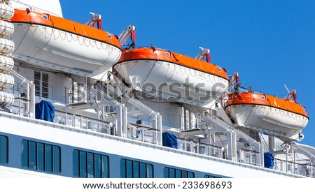 Rescue boats on big passenger cruise ship - stock photo