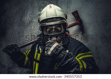 Rescue firefighter in safe helmet and uniform over grey background. - stock photo
