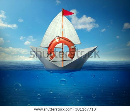 Rescue situation financial bailout support concept. Paper boat safeguarded by lifebuoy ring in a middle of ocean  - stock photo