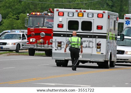 Rescue Vehicles at the scene of an accident - stock photo