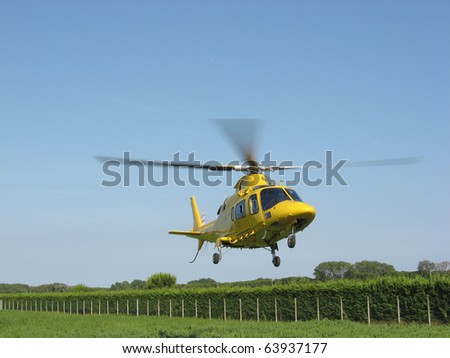 rescue yellow helicopter - stock photo