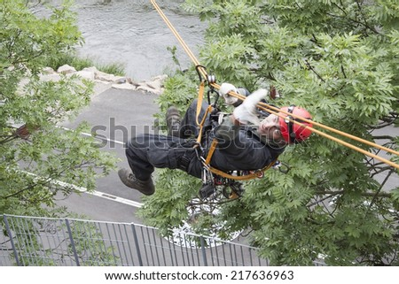 rescuer on the rope, exercise special police units, the real situation, the Czech Republic, the city of Kadan - stock photo