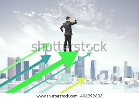 Research concept with businessman on green arrows and city background - stock photo