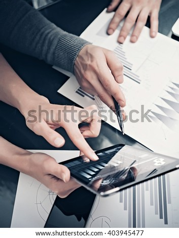 Research department working process.Photo woman showing business reports modern tablet. Statistics graphics screen.Banker holding pen for signs documents,discussion startup idea. Vertical.Film effect - stock photo